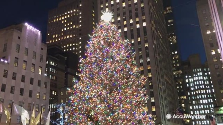 In New York City, the Rockefeller Center Christmas tree lighting up is a  sign of the holiday season in full force. AccuWeather reporter Kena Vernon  is in ... - Rockefeller Center Christmas Tree Lights Up For Holidays King5.com
