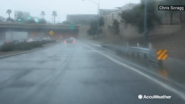 Rain pours into city streets
