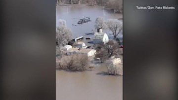 Helicopter rescue of people stranded on rooftop by widespread flooding