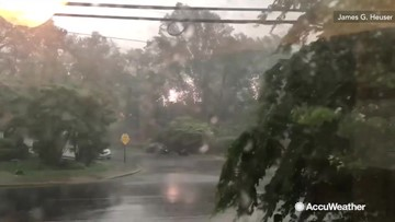 Sparks fly from power lines in midst of wild storm