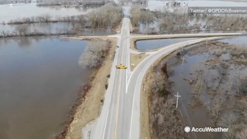 Record flooding engulfs trees and roads