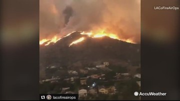 Frightening scene with hills engulfed in flames