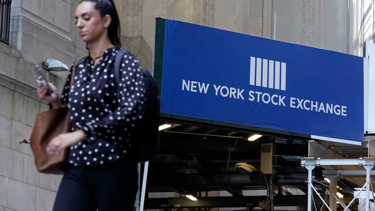 US stocks lower after Fed official sees likely interest rate hikes in 2022