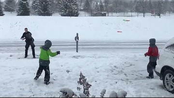 Video: Indiana police officer engages boys in snowball fight on snow day