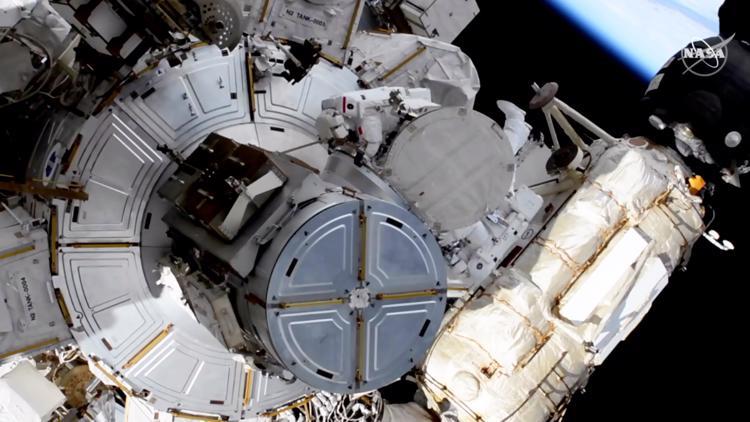Spacewalking astronauts tackle solar panel work