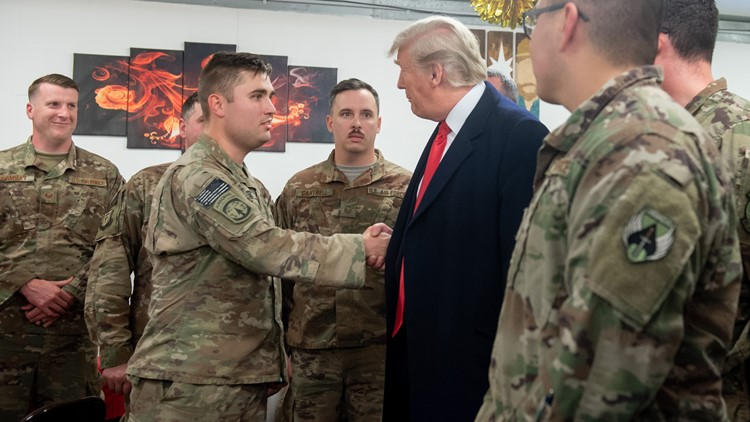 Trump shaking hands with members of the military in Iraq