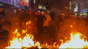 Hong Kong protesters set fires in 13th weekend of protests