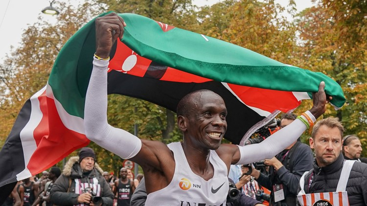 Austria 2 Hour Marathon Attempt celebration with flag