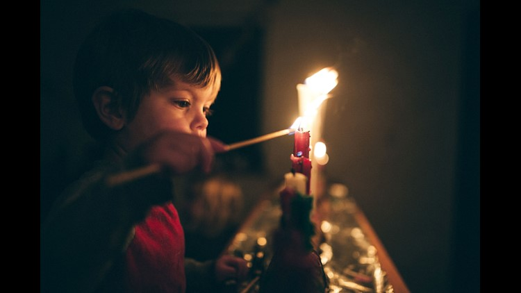 Boy Celebrating Advent Holiday With Candles