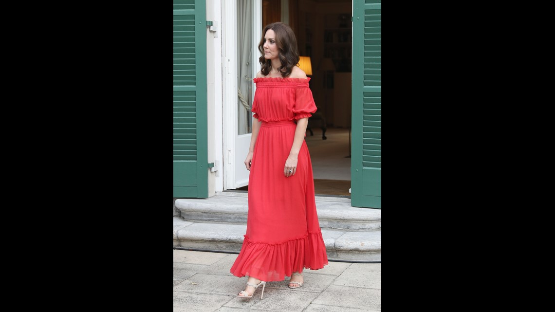 7ecff80e80 Kate had a new look (for her) at the garden party  An off-the-shoulders  maxi-dress in tomato red by Alexander McQueen