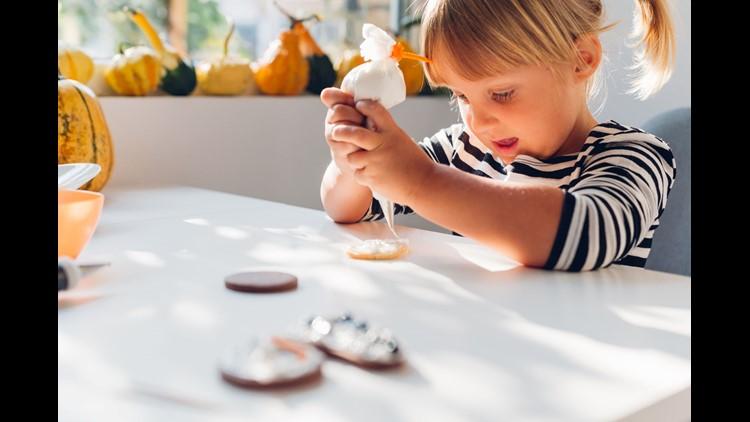 Girl Decorating Halloween Cookies