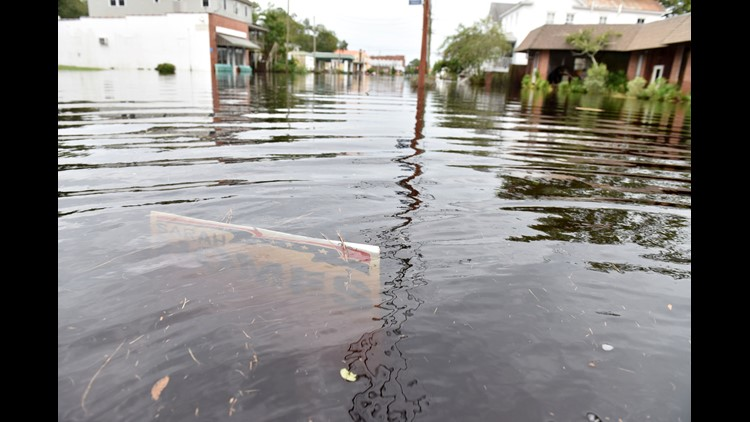 Rivers approached record flood stage and more than 650,000 utility customers were without power Sunday as North Carolina was battered by Florence.
