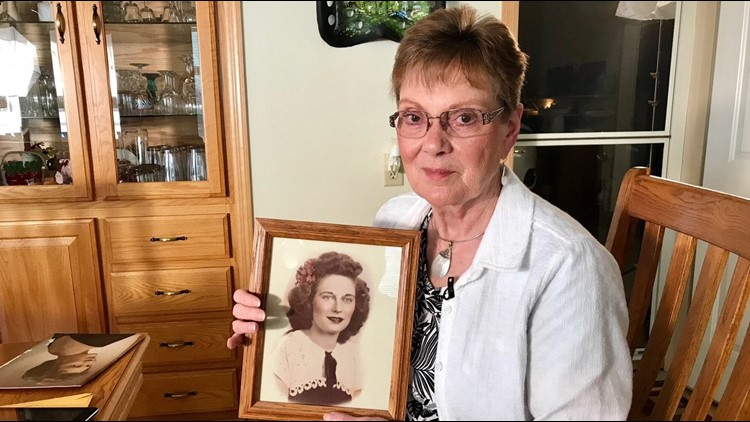 Linda Jourdeans holds a photo of the mother who raised her, Rochelle Nielsen