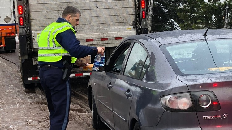 OSP troopers handing out food and fuel