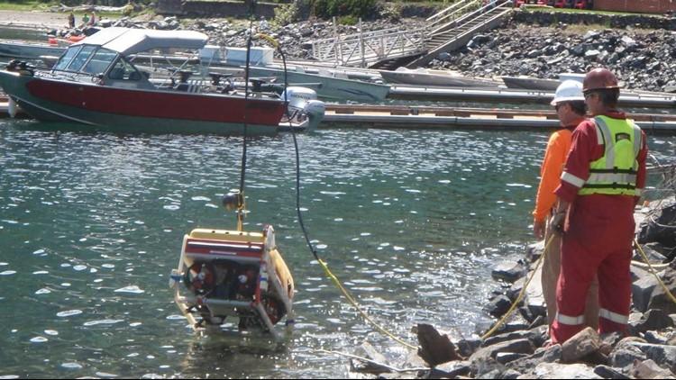 Crews work to retrieve chemical barrels from Wallowa Lake
