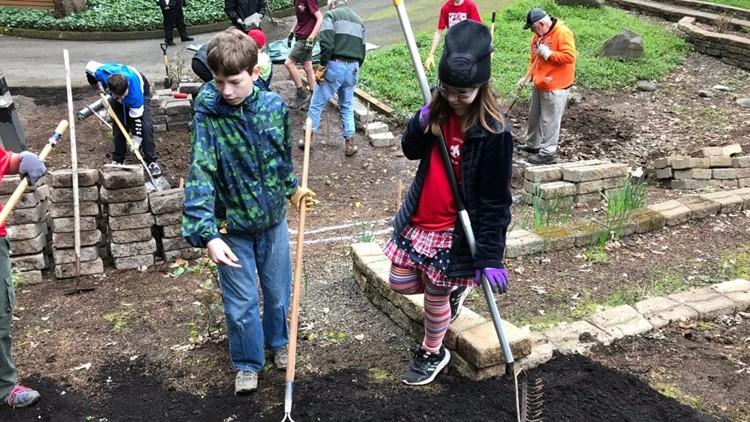 Group of scouts from Tigard build a memorial garden at Tualatin Presbyterian Church