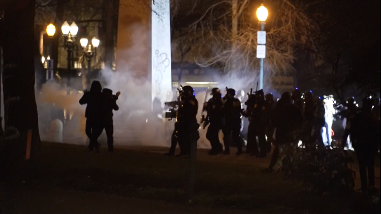 Crowd becomes destructive outside federal courthouse in downtown Portland; officers deploy tear gas