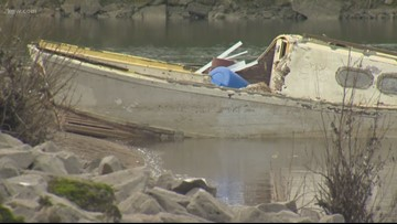 Sunken boat lived in by homeless man costs $60K to remove from Columbia River
