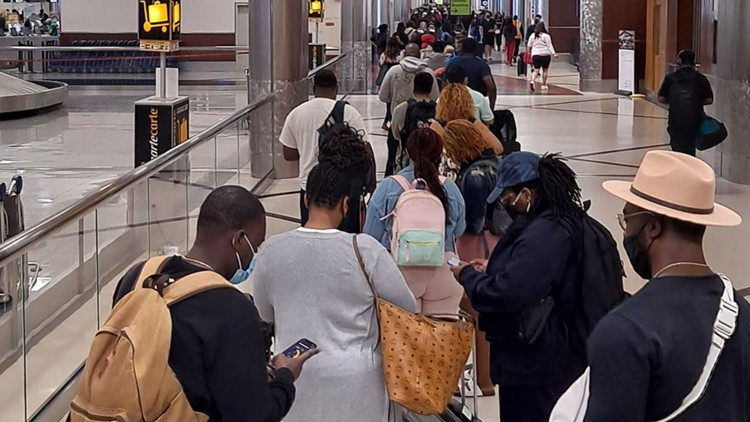 Multiple airlines report early-morning delays due to technical issue checking passengers in