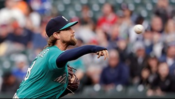 Leake tosses gem, Mariners hit 5 HRs in 14-1 win over Astros