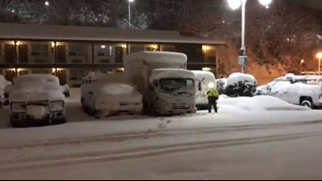 Snow slams Olympic Peninsula, northwest interior but dodges south of Seattle