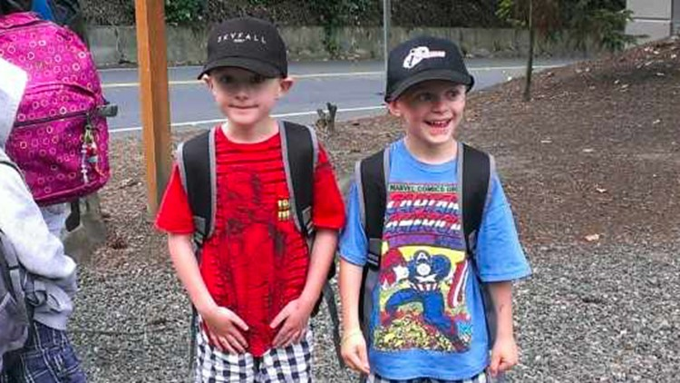 Ryan (left) and Jake Vandell wait for the school bus on the last day of Kindergarten in June 2013.  (Photo: Stacey Vandell)