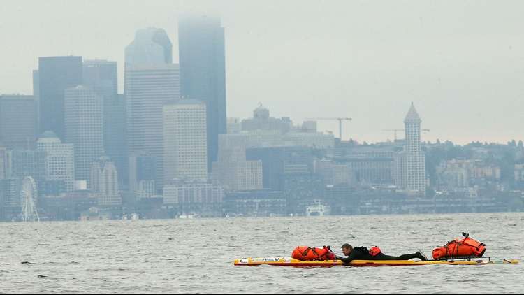Steve Rhoades paddles along the shore of Bainbridge Island's Rockaway Beach. Rhoades was once an addict and was himself homeless for 15 years but now runs an organization called Extreme Sobriety. (Photo: Meegan M. Reid, Kitsap Sun)