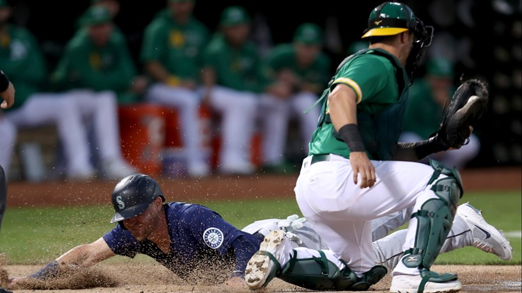 Mariners beat Athletics 5-2 to stay in AL wild-card chase