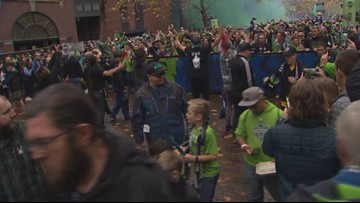 Sounders fans march to CenturyLink Field for MLS Cup
