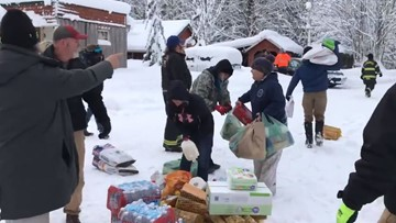 Emergency management, community bring supplies to residents stranded along US 2