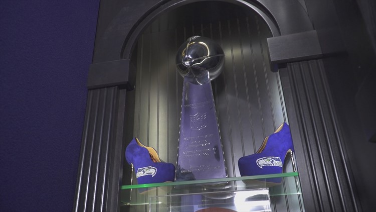 Seahawks stilletos sit next to a replica of The Lombardi Trophy.