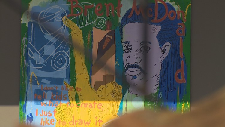 A mural honors Brent McDonald, an art teacher who was murdered in Seattle's Belltown neighborhood in 2015.