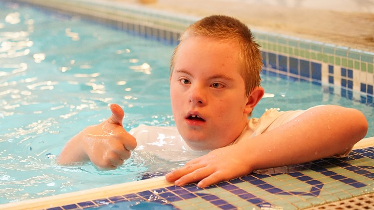 Sam Clayton, a 13-year-old boy with Down syndrome, swims at a Federal Way community center on April 5, 2018.  (Photo: Taylor Mirfendereski | KING 5)