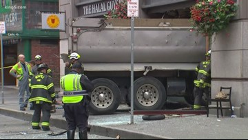 911 calls shed light on moments immediately after a dump truck crashed into a Seattle restaurant