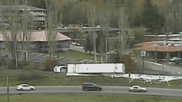 Overturned semi blocking ramp to WB 518; use alternate route to Sea-Tac Airport