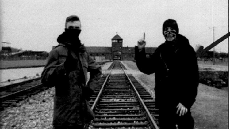 Aiden Bruce-Umbaugh and Kaleb Cole pose at Auschwitz