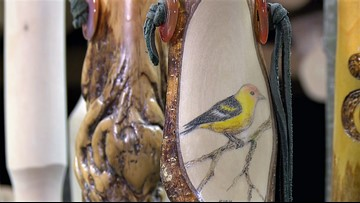 Hand-carved walking sticks are artistic hiking companions