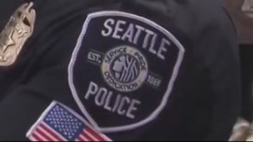 Seattle officer who punched woman in handcuffs should be reinstated, review says