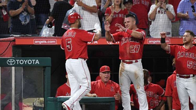Albert Pujols hit two home runs to tie Ken Griffey Jr. for sixth place on the career list with 630, and the Los Angeles Angels rolled to an 11-2 victory over the Seattle Mariners on Thursday night.