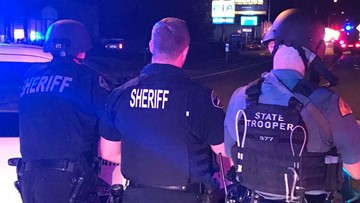 Heavily armed' suspect in custody after Tacoma hostage