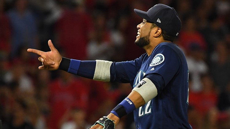 Robinson Cano hit a go-ahead three-run double to cap the Seattle Mariners' rally from a four-run deficit in a 6-5 win over the Los Angeles Angels on Saturday night.