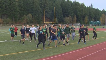 Prep Zone: Emerald Ridge cross country team line dancing their way to victory