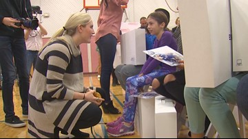 US Olympians surprise Burien students with free laptops