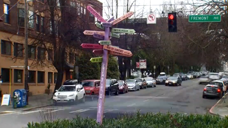 Volunteers in Fremont begin remaking the 'Center of the Universe' sign