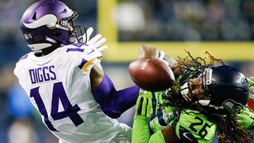 Late-game heroics push Seahawks past the visiting Vikings, 21-7