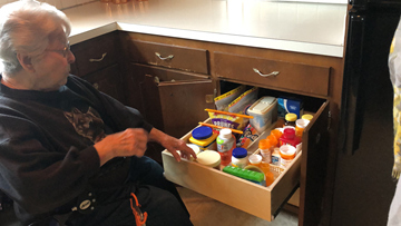 Keep those deep kitchen cabinets and low shelves within reach