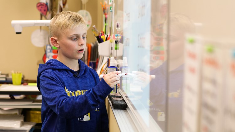 Jake Vandell, 11, writes a word on the board in front of his fifth-grade classmates at the Hamlin Robinson School on June 1, 2018. (Photo: Taylor Mirfendereski   KING 5)