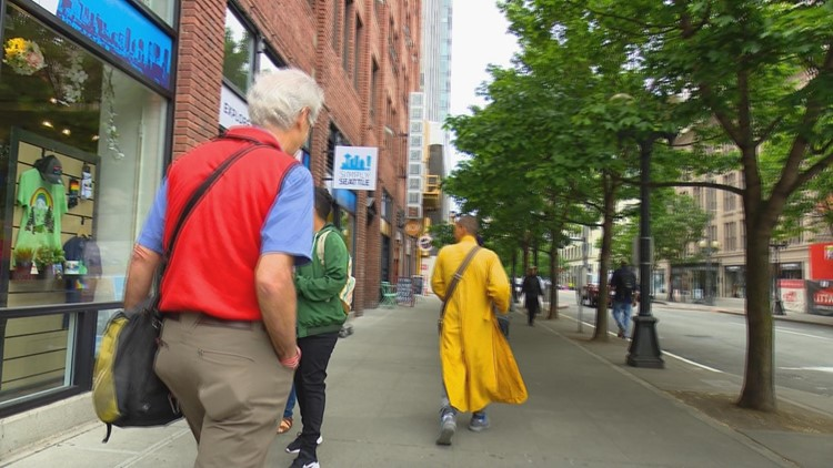 Editor of NW Dharma News Steve Wilhelm questions a man in monk's robes.