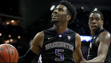 Huskies hold off Oregon's late rally for 61-56 win