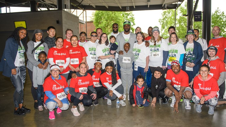 Hop on your bike and join former Seahawk Cliff Avril's 'Beat the Bridge' team